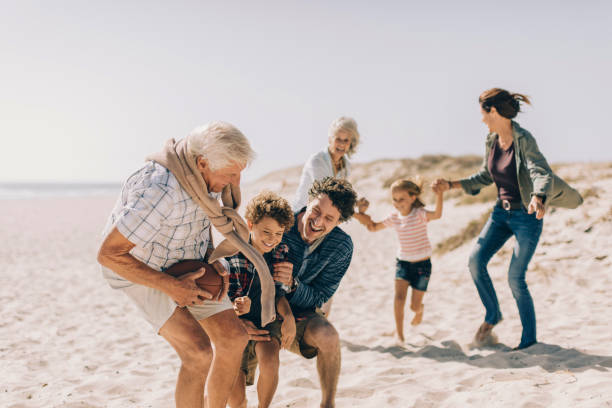 playful family - multi generation family stock photos and pictures