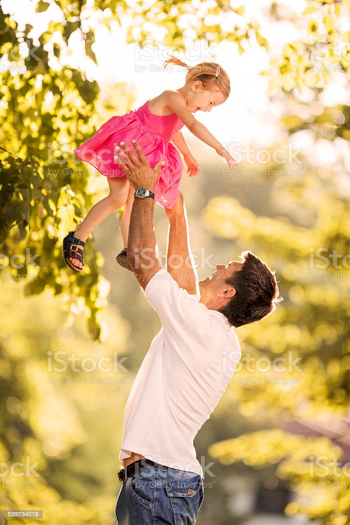 Playful father and daughter outdoors. royalty-free stock photo