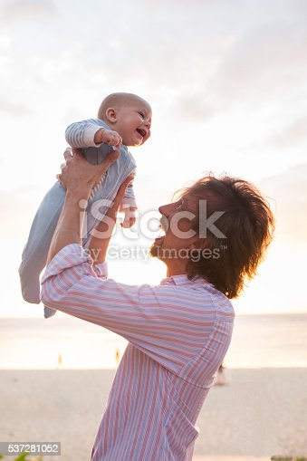 istock Playful father having fun with cheerful baby boy. 537281052