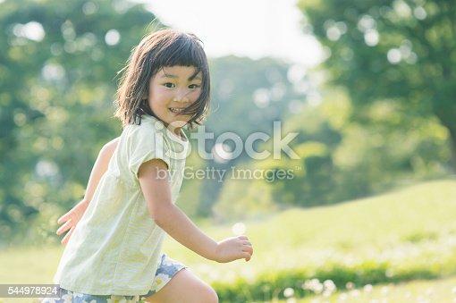 istock Playful girl having fun time in nature 544978924