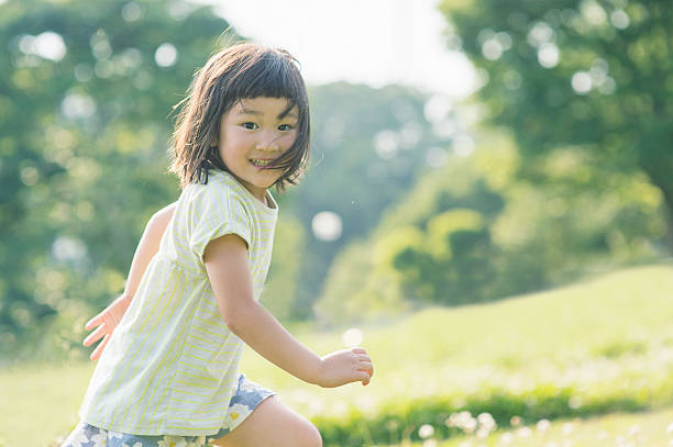 Playful girl having fun time in nature stock photo