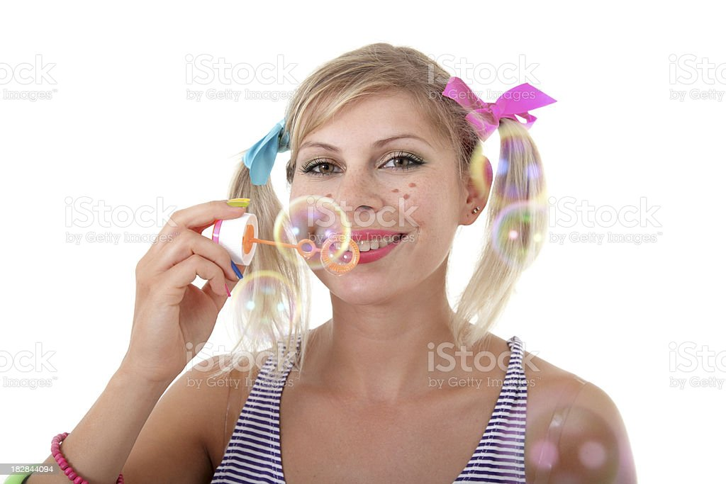 Playful girl with bubble blower stock photo