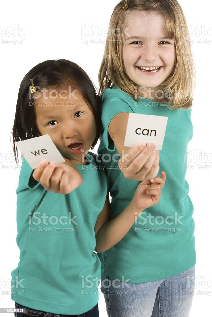 Playful girls holding sight word cards royalty-free stock photo