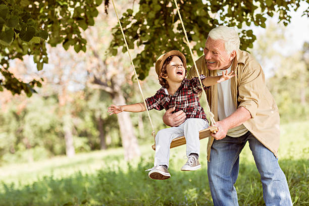 Playful grandfather Playful grandfather spending time with his grandson grandson stock pictures, royalty-free photos & images