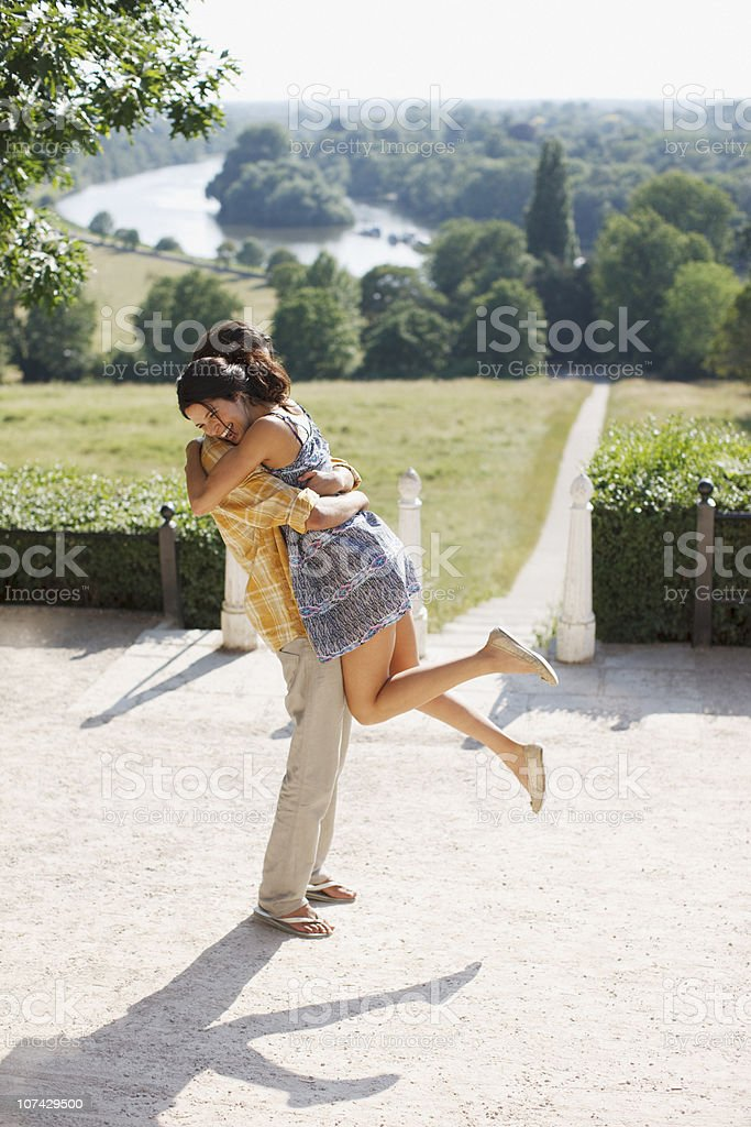 Playful, happy couple hugging outdoors royalty-free stock photo