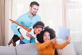 istock Playful Happy family take a selfie with digital tablet 540611474