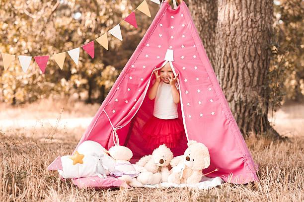 playful kid girl outdoors - weidentipi stock-fotos und bilder