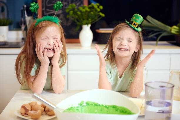 playful kids enjoying with the flour - st patricks day food stock photos and pictures