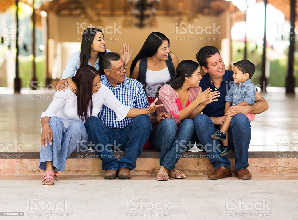 Playful latin family having fun stock photo