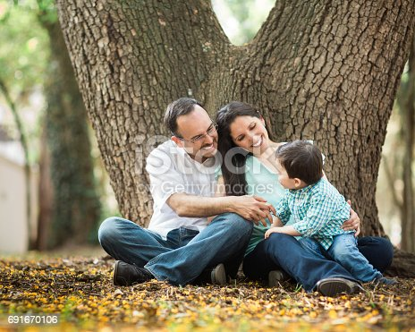 811227514 istock photo Playful latin family with one boy smiling at each other 691670106