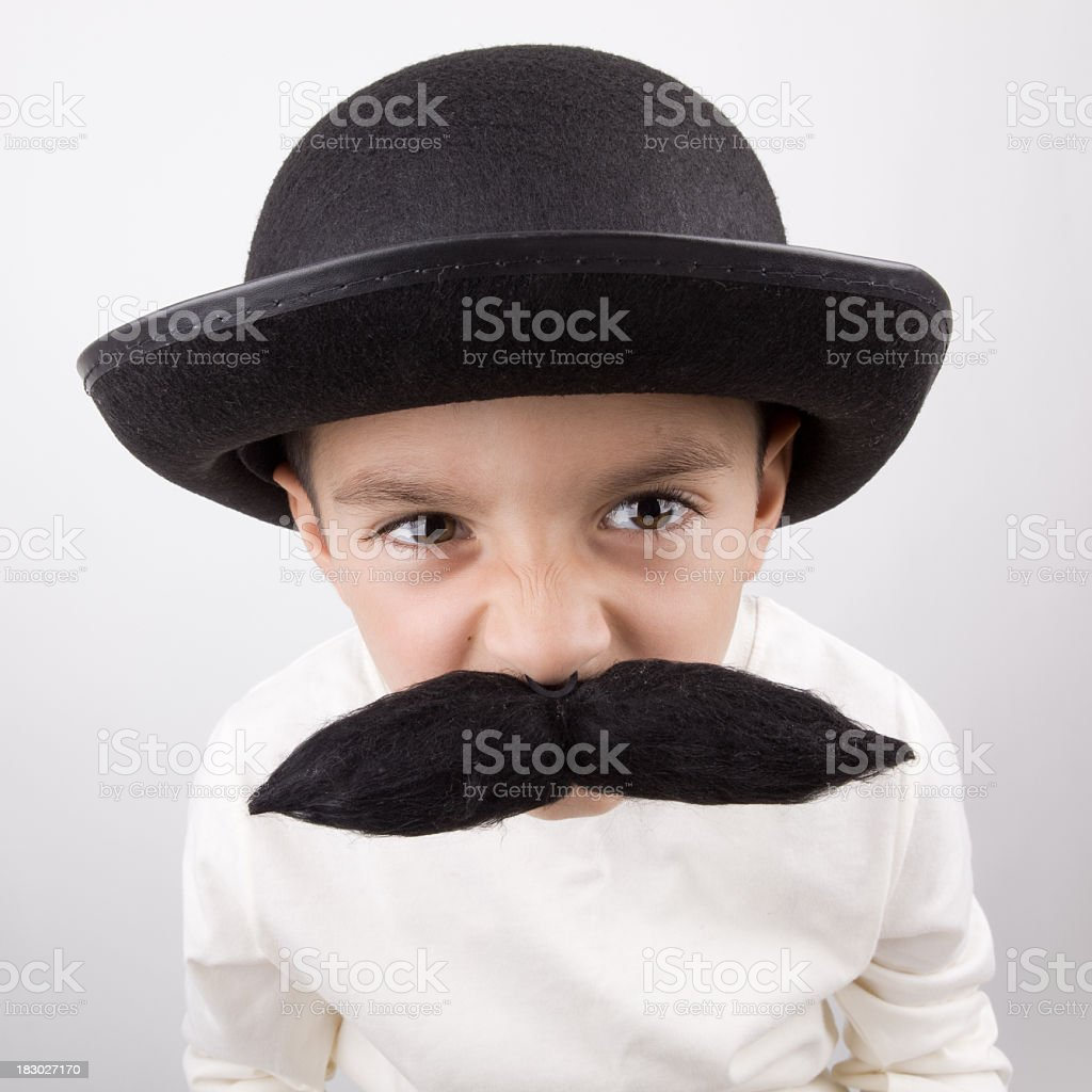 Playful Little Boy With Big Handle Bar Mustache And Hat royalty-free stock photo