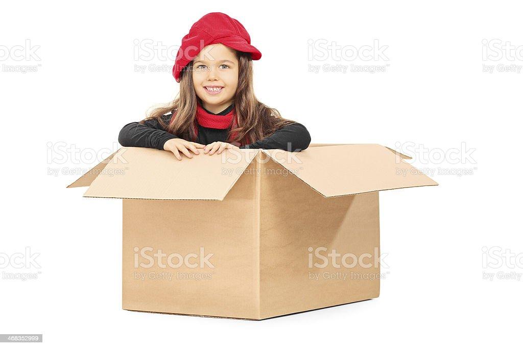 Playful little girl in carton box royalty-free stock photo