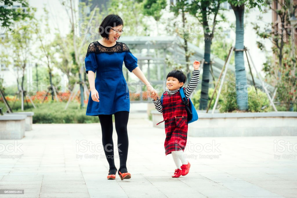 Playful little girl running beside her mother - Royalty-free 4-5 Years Stock Photo