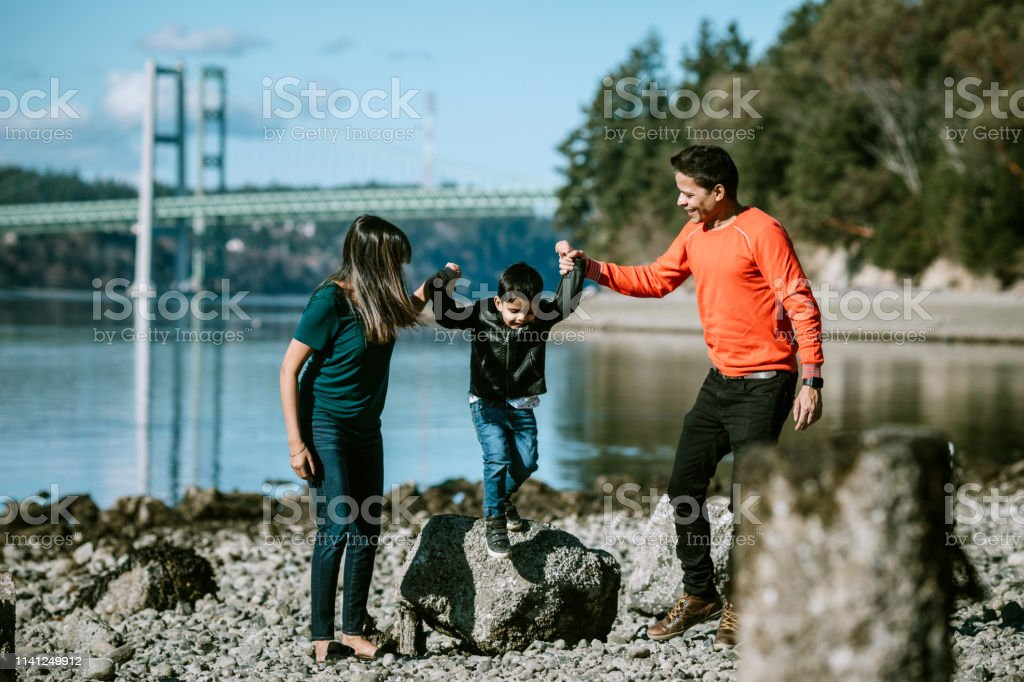 Playful Loving Indian Family At Beach Together stock photo