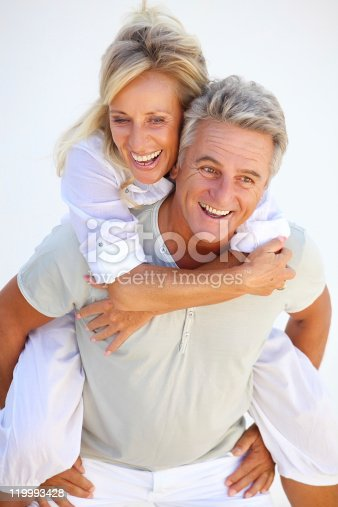 119998253 istock photo Playful mature couple 119993428