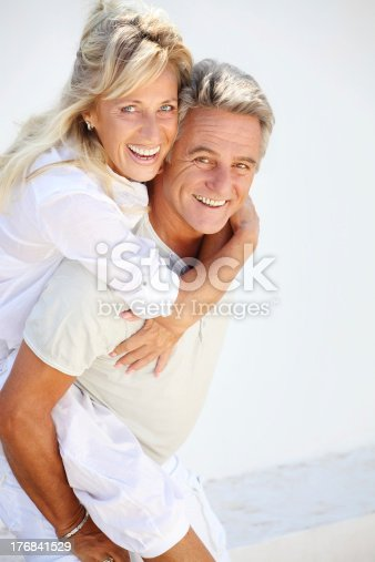 119998253istockphoto Playful mature couple 176841529