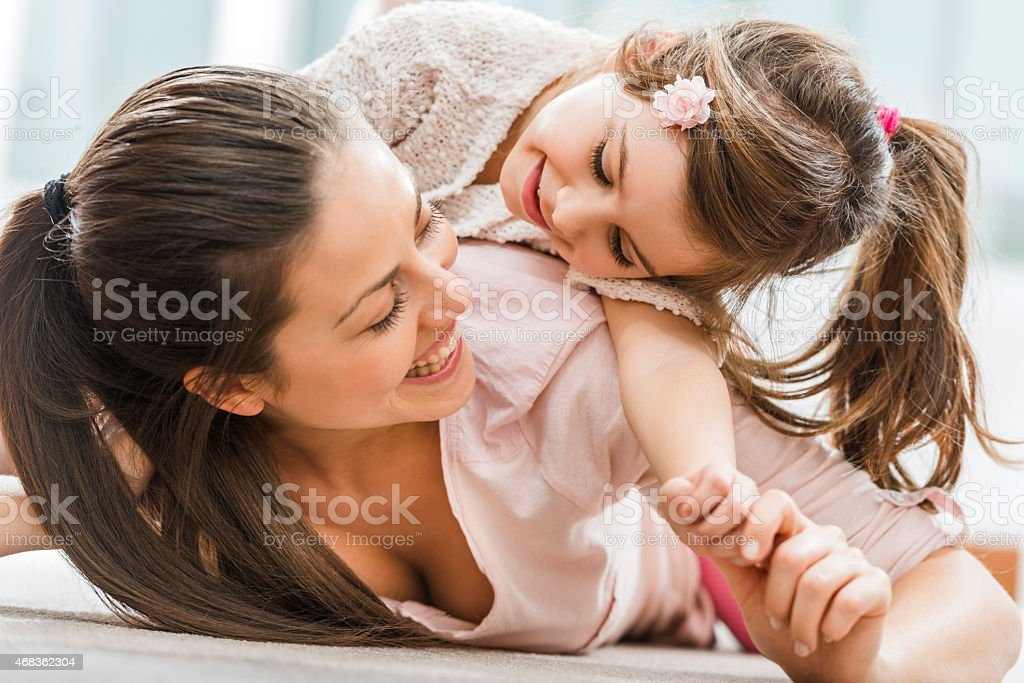 Playful mother and daughter at home. royalty-free stock photo