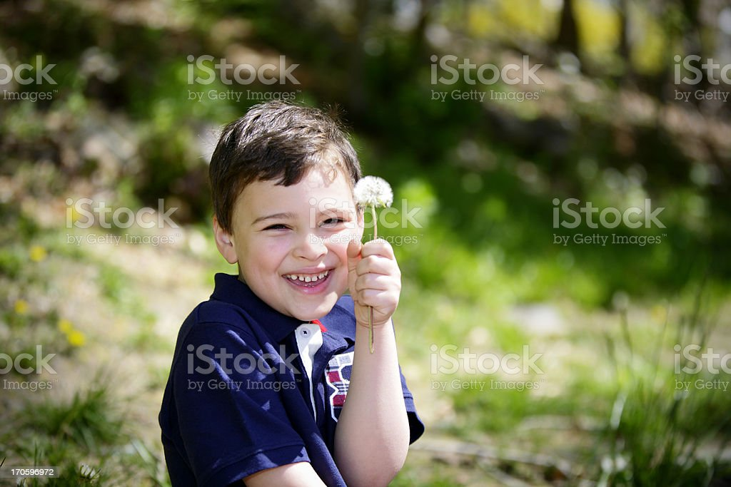Playful portrait of a boy with special needs royalty-free stock photo