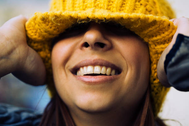 Playful portrait of a young woman wearing a beanie stock photo