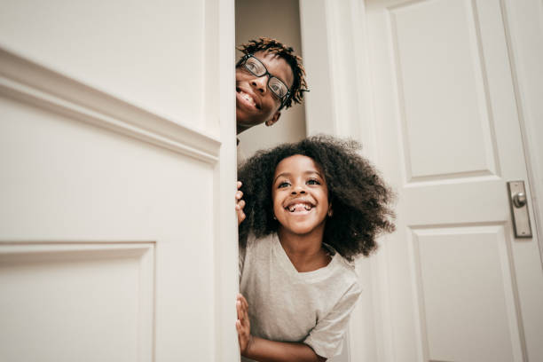 Playful siblings Playful siblings hide and seek stock pictures, royalty-free photos & images