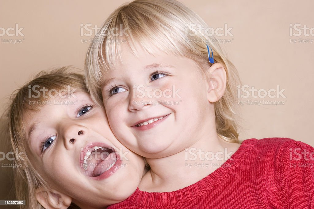 Playful Sisters stock photo