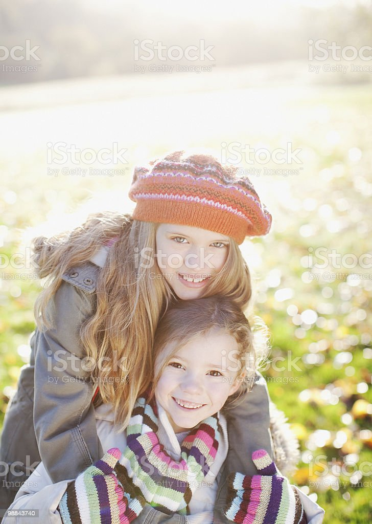 Playful sisters smiling outdoors in autumn royalty-free stock photo