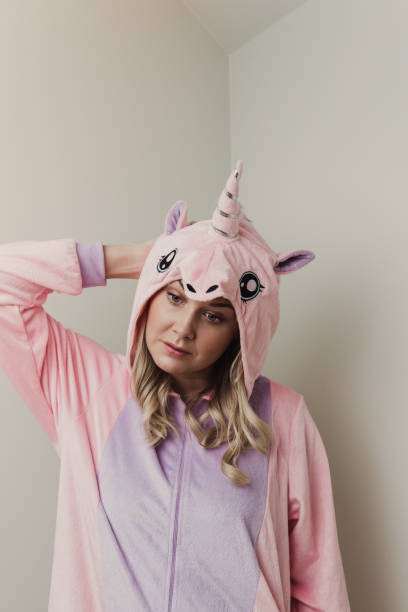 playful woman in unicorn costume. - unicorn bed imagens e fotografias de stock