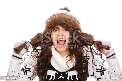 istock Playful Woman in winter clothes 1073679236