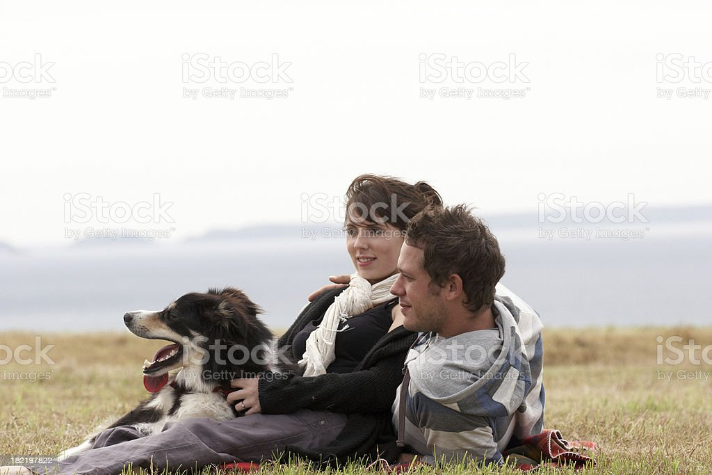 Playful young couple and dog at picnic - Royalty-free 20-24 Years Stock Photo