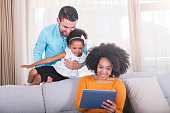 istock Playful young family at home 540611470