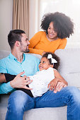istock Playful young family at home. 540611556