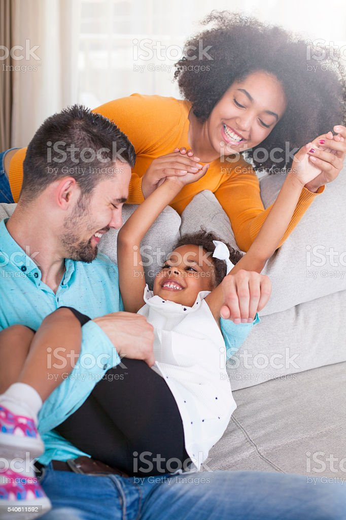 Playful young family at home. stock photo
