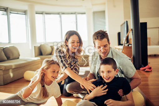 611179902istockphoto Playful young family 603865704