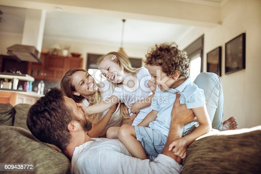 611179902istockphoto Playful young family 609438772