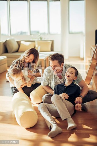 istock Playful young family 611179820