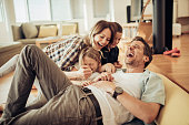 Close up of a happy young family having good time together.