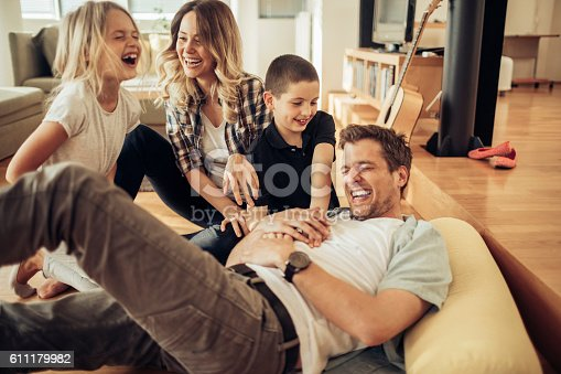 611179902istockphoto Playful young family 611179982