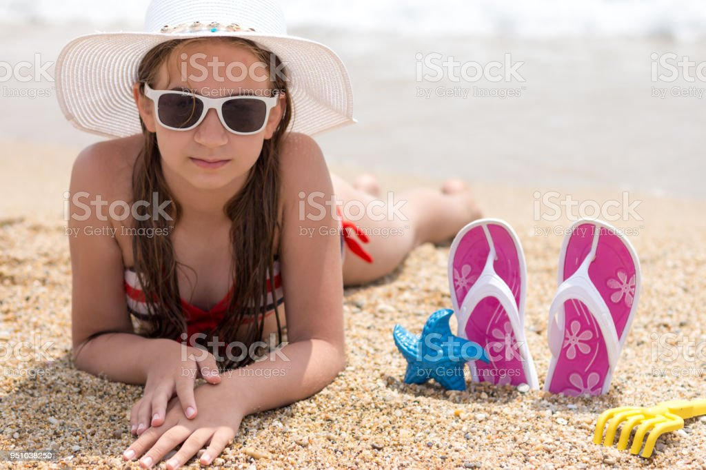 Playful young girl enjoying on the Bech stock photo