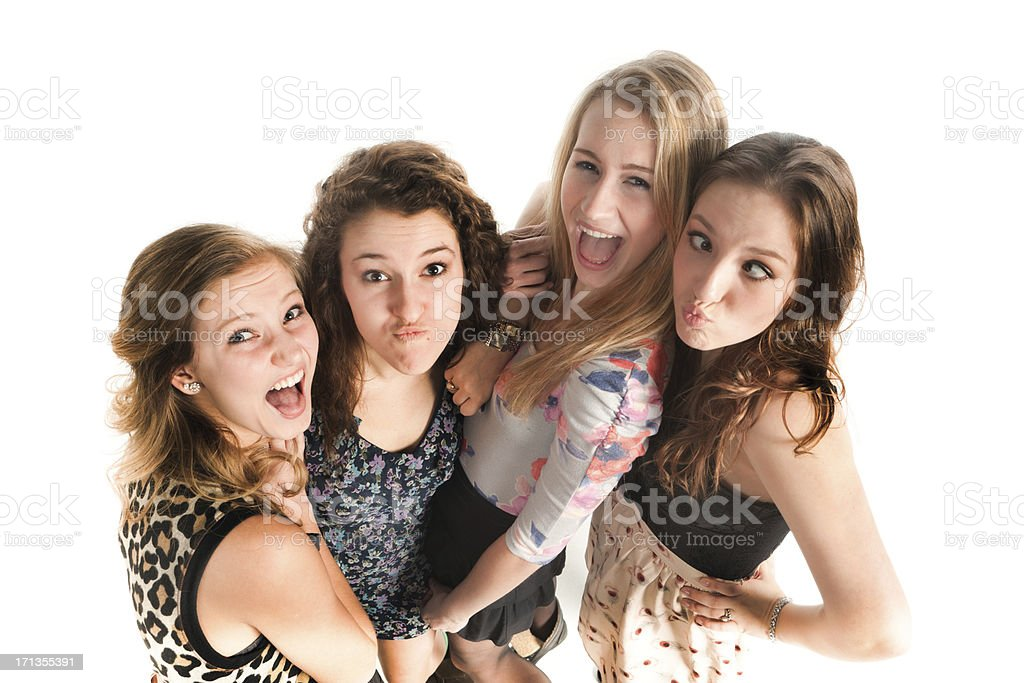 Playful Young Girls Making Faces at Camera on White Background stock photo