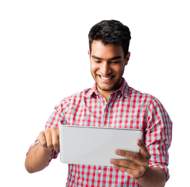 Playful young man using digital tablet and smiling stock photo