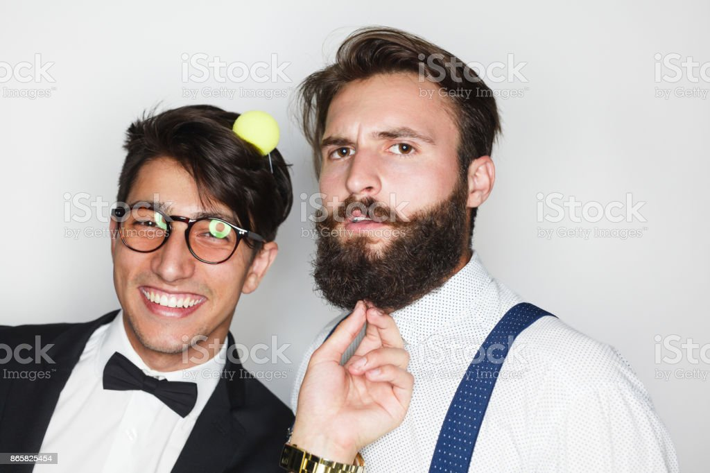 Playful young men in elegant clothing stock photo