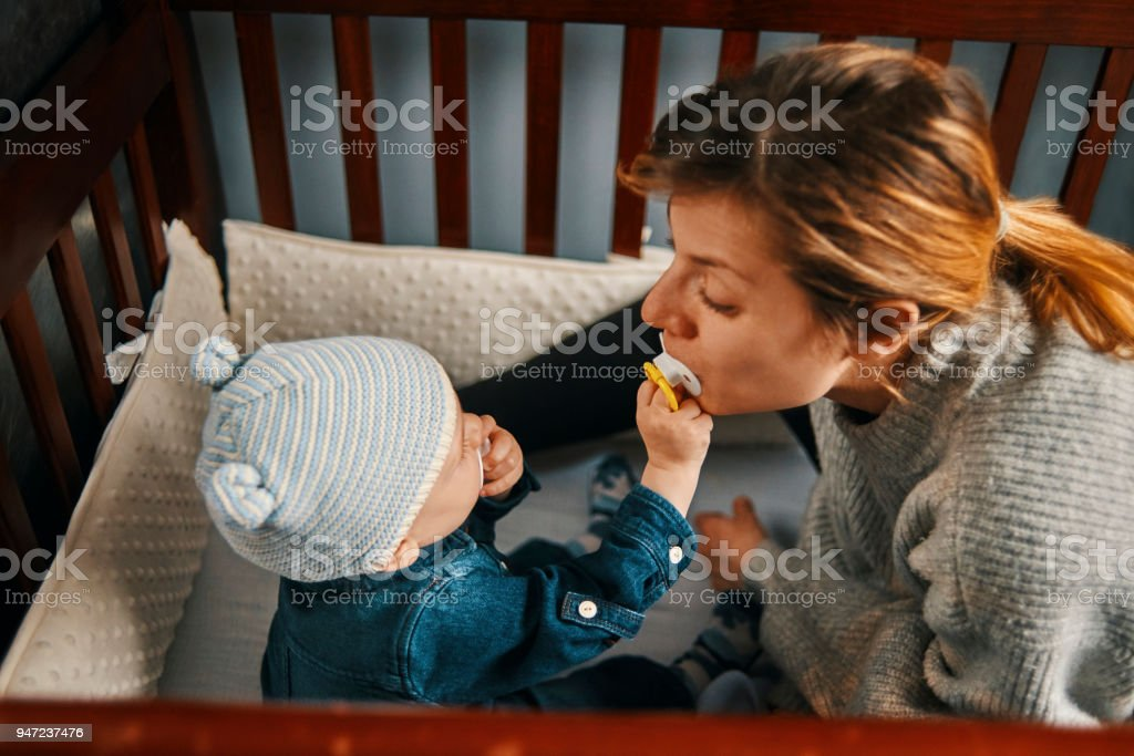 playful young mother and her baby stock photo