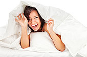 istock Playful Young Woman on Bed Hiding Under Covers 155602556