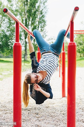 istock Playful young woman 528499316