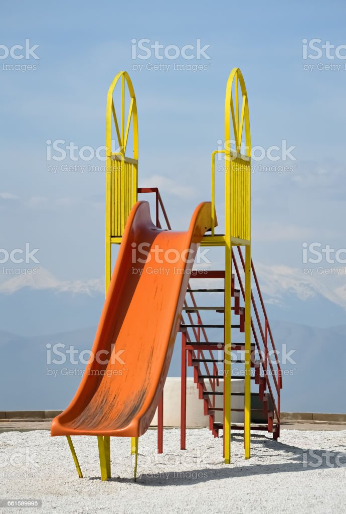 Playground and slider in the nature in a beautiful spring day stock photo