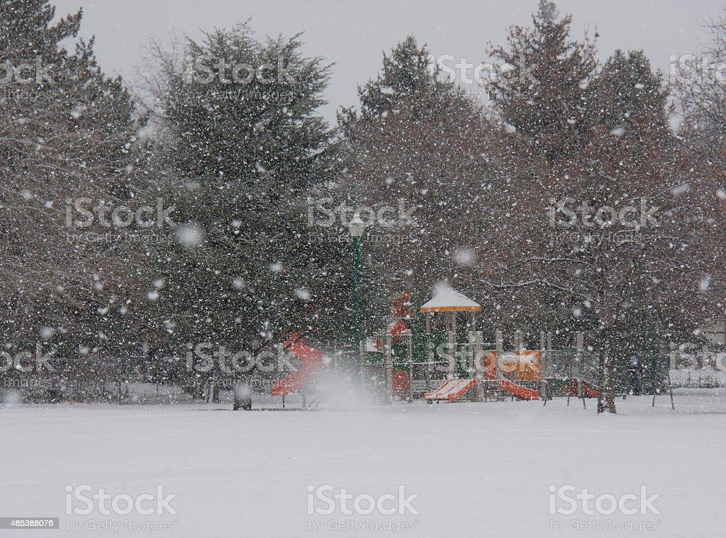 Playground in Snow Storm stock photo