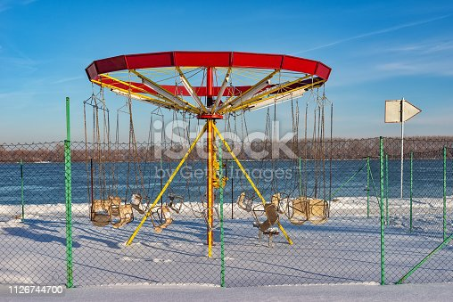 Playground in the winter with a carousel under the snow