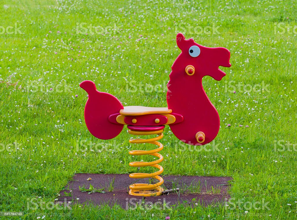 Playground spring Horse in a meadow full of white flowers stock photo