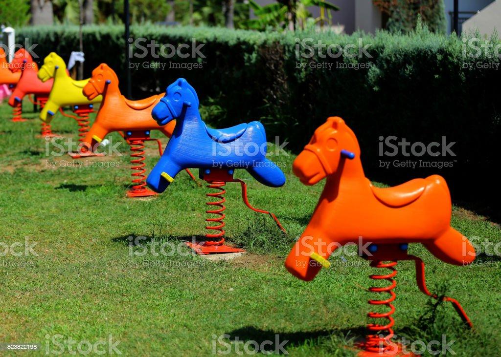 Playground spring Horse on grass stock photo