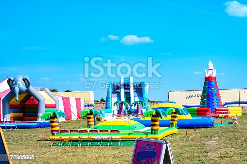 Grossziethen, Germany - September 1, 2019: Playground with bouncy castles on a meadow to romp for children in the countryside of Berlin.